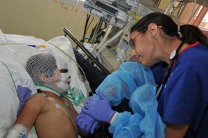 A 3-year-old Syrian girl is treated in a children's intensive care unit.