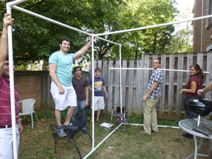 Moishe House Arlington residents and friends build their sukkah. The house opened Sept. 1 as a hub for young adults in Northern Virginia. Courtesy Moishe House Arlington