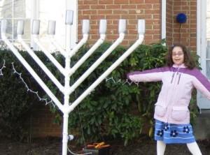 Rachel Robin stands byher family's menorah in 2008. The menorah was vandalized days after her bat mitzvah in December. Photo by Ellen Robin