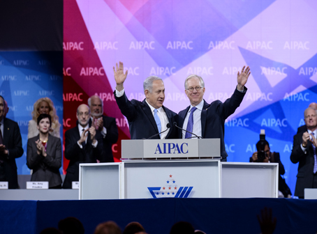 Israeli Prime Minister Benjamin Netanyahu and AIPAC President Michael Kassen embrace and wave to the crowd Tuesday morning at AIPAC's annual three-day conference in Washington. Photo courtesy of AIPAC