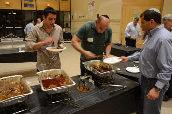 Beth Sholom's fourth annual Guys' Night Out featured ribs, grilled chicken and scotch for more than 500 attendees. Photos by Max Moline