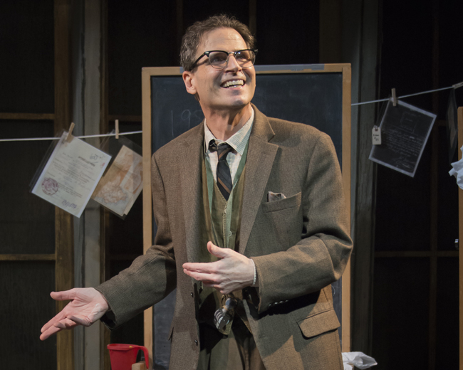 """In search of a lost fine: Paul Morella plays the Librarian in """"Underneath the Lintel."""" Photo by Chris Banks"""