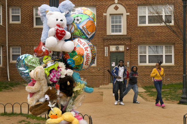 "Shrine to Erica Peters, 36 and her chidren Eric, 11, and Dakota, 10, who were killed March 21st in their apartment ( 2000 Maryland Ave NE, Washington DC ) apparently by the children's father Joseph Randolph Mays, who was arrested ( he wounded himself- the murder weapon was a knife). A third child was placed with DC Child protective services. I met a man, Roland, 53, at the site. His grandkids, who he cares for, woke him to see the bodies being carried out. He said over & over ""It hurt."" The kids are afraid it may happen to them. They playe dwith the Peters kids often. He prays for more police protection. The grandkkids are having nightmares. Loss, fear... how do you explain this to children, Said Ms. peters was kind, friendly, only went to her job, church, and took care of the kids."