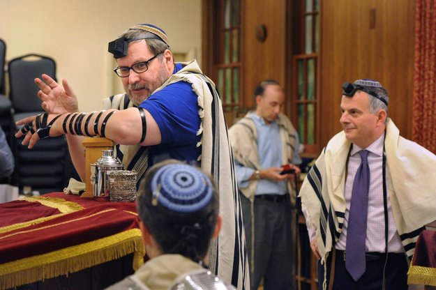 Right:Rabbi Barry Freundel of Kesher Israel in Georgetown wears tefillin for the  morning service. Photos by Lloyd Wolf