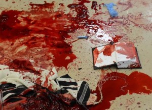 Blood on prayer shawls and prayer books seen inside the synagogue where  two Palestinian terrorists from East Jerusalem entered the Kehilat Yaakov synagogue in the Jewish orthodox neighborhood of Har Nof, Jerusalem, with pistols and axes, and began attacking Jewish worshippers. Four Jewish worshippers were killed and several more injured. The attackers were shot and killed at the scene.  November 18, 2014. Photo by Kobi Gideon/GPO/FLASH90
