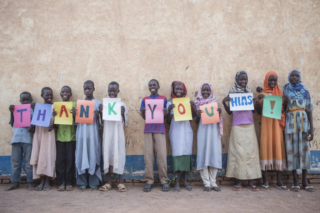 "Darfuri refugees at Farchana in Chad in 2013 say ""thank you"" to HIAS.  Photo by Glenna Gordon/HIAS"