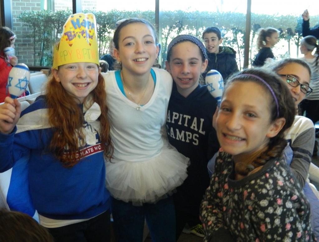 Students in Temple Beth Ami's Machane L'mata program feel the Chanukah spirit. Photo by David Holzel