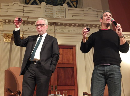 Wolf Blitzer (left) and Andy Cohen drink toasts of Manischewitz at Sixth & I Historic Synagogue Photo by Bruce Guthrie, courtesy of Sixth & I