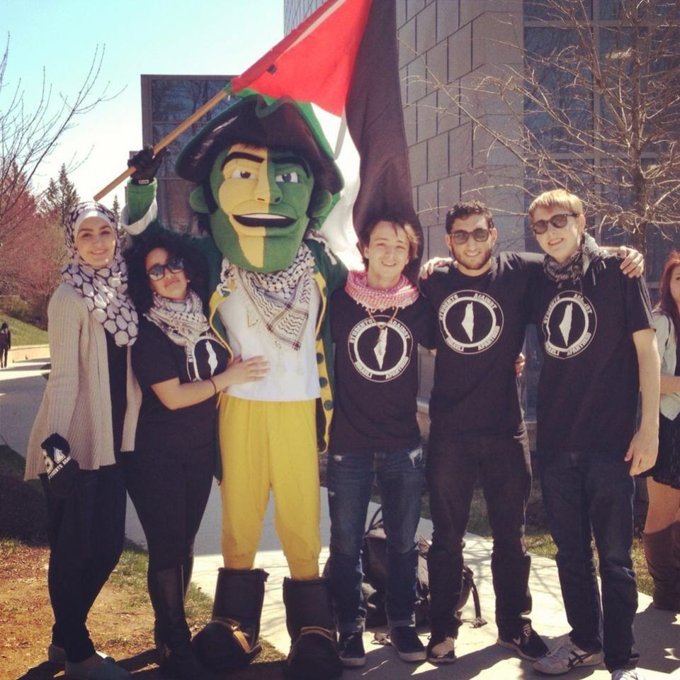 Students Against Israeli Apartheid with the Mason Patriot sports mascot. Students Against Israeli Apartheid Facebook page