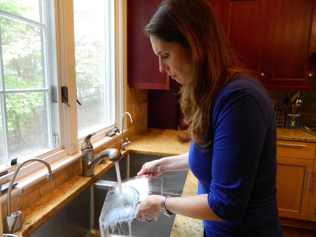 Kosher cookbook author Paula Shoyer washes dishes in her sink, which has two sides, one for meat and one for dairy. Photo by Josh Marks