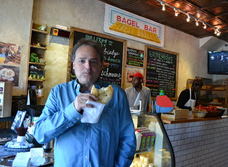 Mosaic Theater Company of DC Artistic Director Ari Roth gets his bialy fix at Bullfrog Bagels on H Street. Photo by Josh Marks