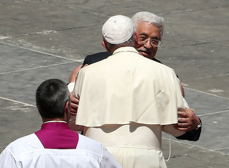 ope Francis greeting Palestinian Authority President Mahmoud Abbas as the pope leaves St. Peter's Square at the end of a canonization ceremony in Vatican City earlier this month.   (Photo by Franco Origlia/Getty Images)