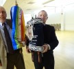Sid Sussan, left, and Allan Firestone hold the old and new Torahs. Photo by Suzanne Pollak