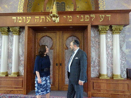 Rabbi Haim Ovadia and his wife, Edna, stand in front of the ark at Magen David Congregation, where he was recently hired as the rabbi. Photo by Suzanne Pollak