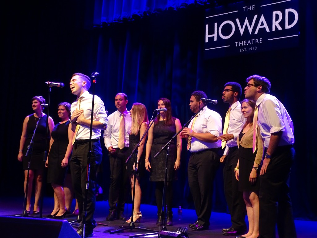 The Word of Mouth a cappella group performs on stage at the Howard Theater for Impact DC.Photo by Josh Marks