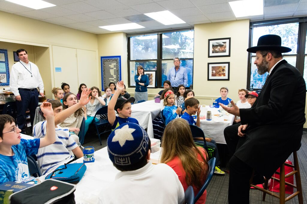 Rabbi David Lau, the Ashkenazi chief rabbi of Israel, speaks to students at the Jewish Primary Day School of the Nation's Capital.Photo by Moshe Zusman
