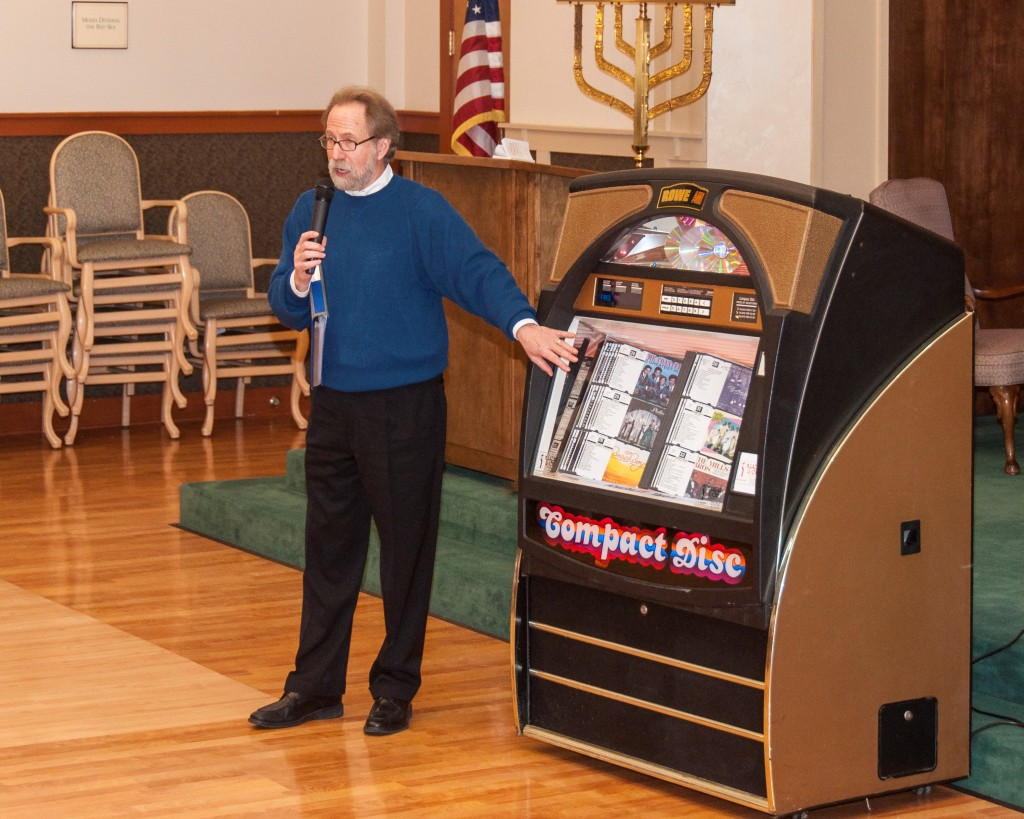 Jukebox Memories Project founder Dale Lazar demonstrates the first of three jukeboxes donated to the Charles Morris Nursing and Rehabilitation Center in Pittsburgh.Photo by John Schiller