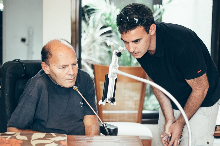 Oded Ben Dov (right) worked with potential phone users to develop a Smartphone that is controlled by head movements. It was developed by an Israeli startup.Photo by Basti Hansen