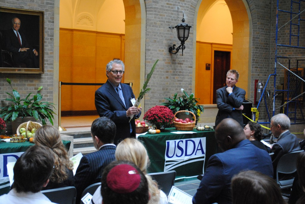 Rabbi Jack Moline, executive director of Interfaith Alliance, explains the lulav and etrog as USDASenior Advisor Max Finberg lookes on.
