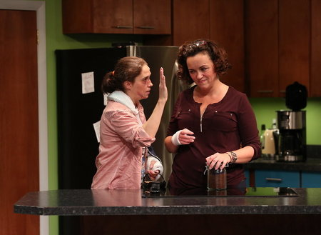 Molly (Holly Twyford), left, attempts to keep the peace with her sister Linda (Emily Townley) in Olney Theatre Center's production of Bad Dog. Photo by Nicholas Griner