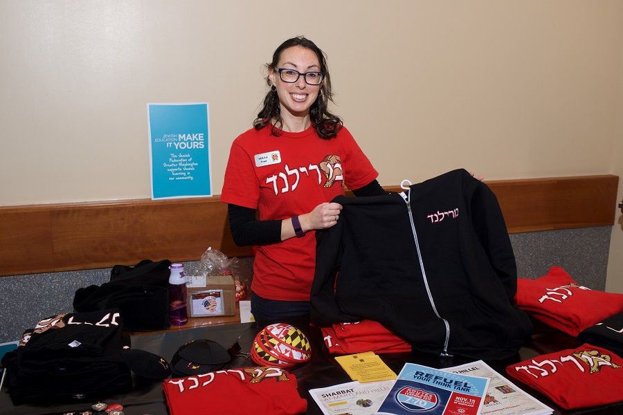 Shuli Tropp, director of institutional advancement at University of Maryland Hillel, shows off Maryland Hillel swag.