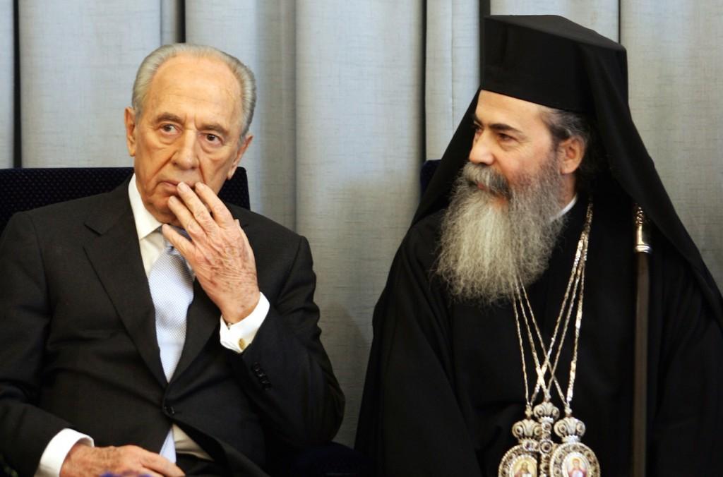 Israeli President Shimon Peres, left, meets with the Greek Orthodox patriarch  of Jerusalem, Theofilos III, in Jerusalem in 2007. Photo by Kobi Gideon/FLASH90