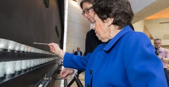 27 January 2016, Holocaust Survivor Johanna Neumann lights a candle with German Ambassador Peter Wittig during the International Holocaust Remembrance Day ceremony at the US Holocaust Memorial Museum.