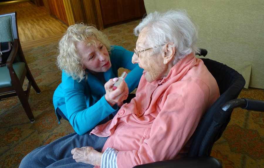 Marlene Goldschmidt applies makeup to her mother, Florence Halpern, who suffers from Alzheimer's disease. Photo by Suzanne Pollak