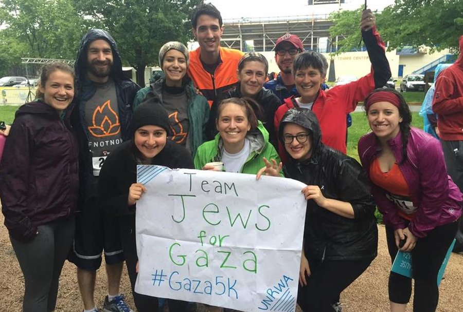 Rain-soaked members of Jews for Gaza raised $3,700 to support summer camp for Gaza children. Photo by Katie Ashmore