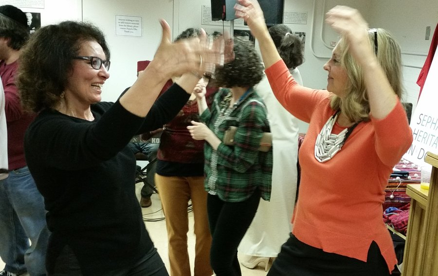 The Mimouna celebration included dancing and food. Photo by Daniel Schere