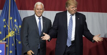Presumptive US Republican presidential candidate Donald Trump (R) and Indiana Governor Mike Pence (L) take the stage during a campaign rally at Grant Park Event Center in Westfield, Indiana, on July 12. 2016.  Photo by TASOS KATOPODIS/AFP/Getty Images)