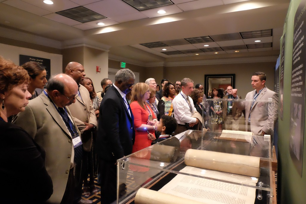 Participants at an event sponsored by Yad Vashem and the Museum of the Bible view the Codex Valmadonna I, the only surviving Hebrew text from England dated before the expulsion of the Jews in 1290.  Photo by Jake Romm