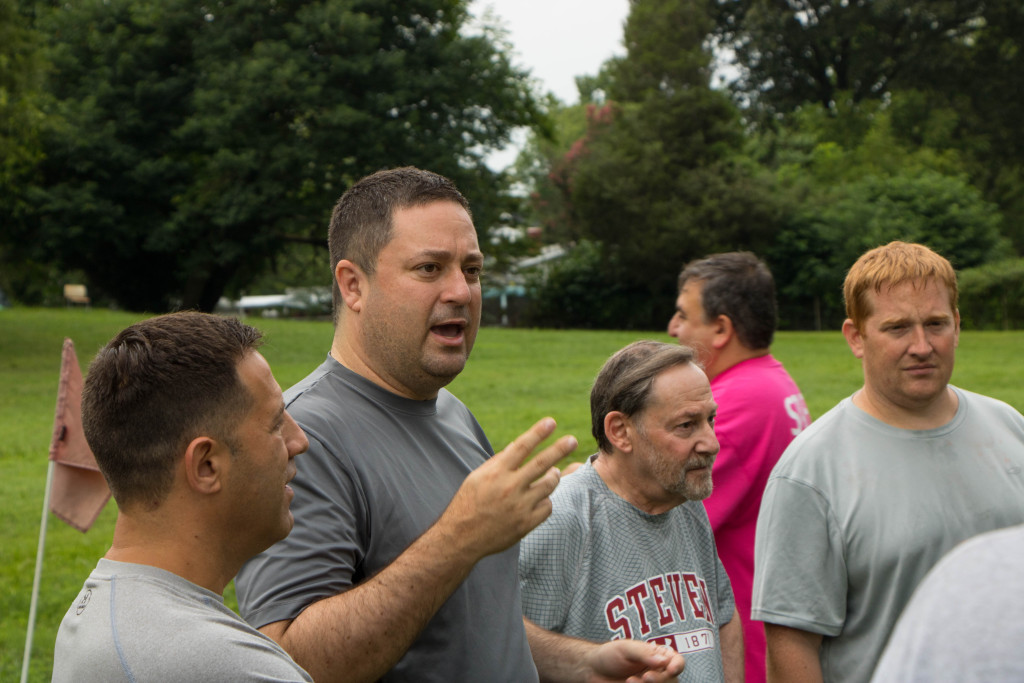 Jim Kaplan, second from left, rallies his team from Congregation Olam Tikvah before the game's start.