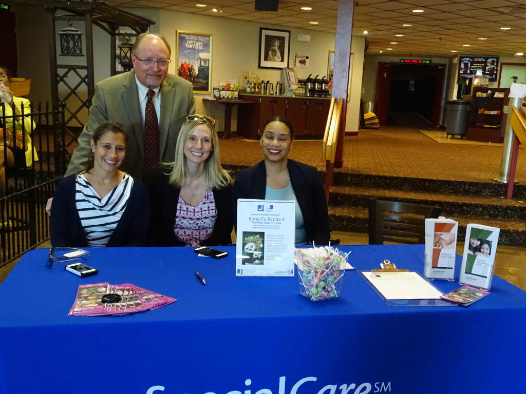 Welcoming families to a sensory-friendly movie night are, from left, Jessica Tischler, Jerry Hulick, Carey Alford and Michelle Jefferson. Photo by Jared Feldschreiber