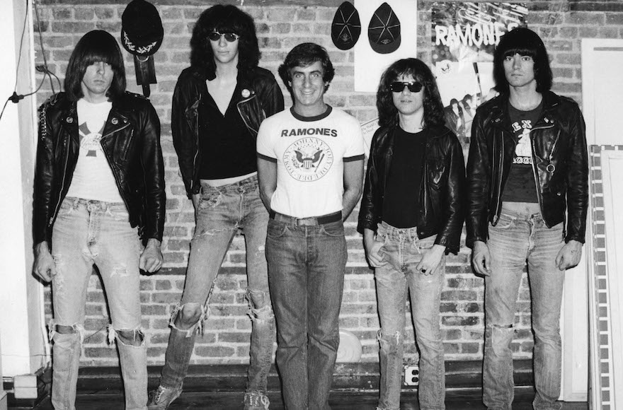 Danny Fields, center, without black jacket, with the members of the Ramones.  Photo courtesy Magnolia Pictures via JTA