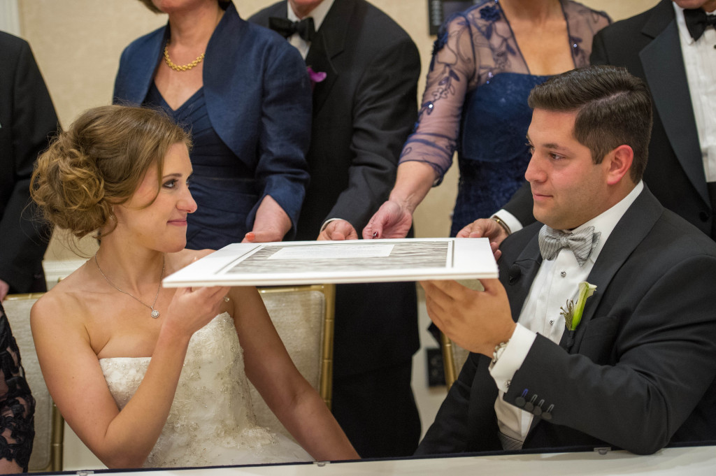 Kirsten and Jonathan Sidell pause after signing their ketubah in October 2015 Photo provided