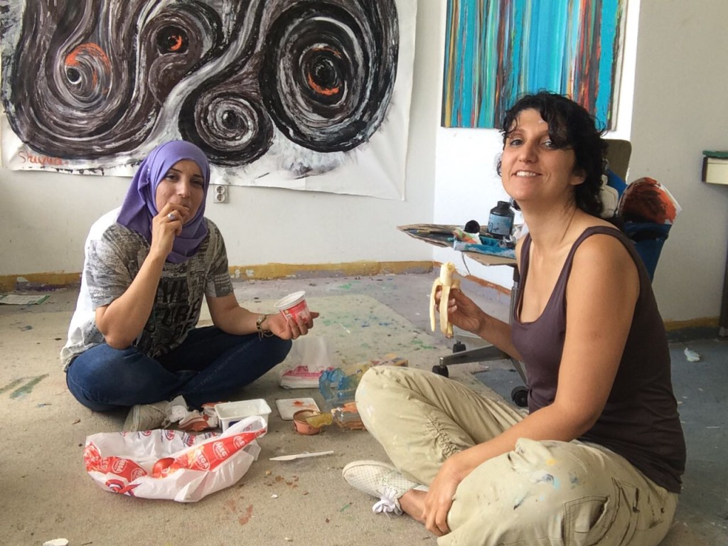 Lunch in studio: Siegel, right, and Egbariah often enjoy a picnic lunch on the floor of their shared studio. Photo courtesy of Shirley Siegel