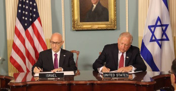 Jacob Nagel, left, Israel's acting national security adviser, signs a Memorandum of Understanding for $38 billion of U.S. defense assistance over 10 years with Under Secretary of State Tom Shannon, on Sept. 14. Photo: Embassy of Israel