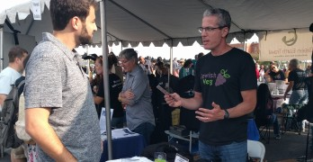 Jeffrey Cohan, executive director of Jewish Veg, talks to Dave Saxe of Washington at the DC VegFest.  Photo by George Altshuler