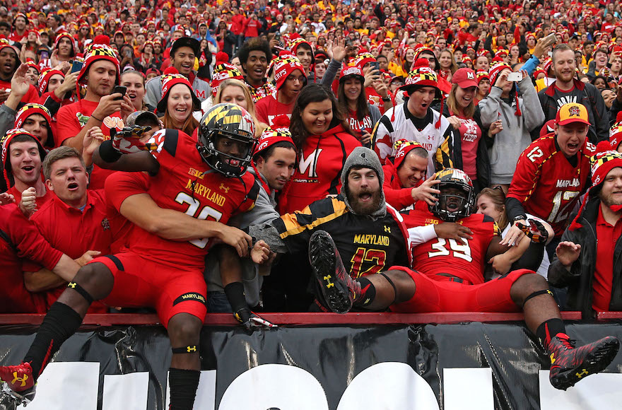 Some University of Maryland Terrapins players jump into the stands before playing the Wisconsin Badgers at Byrd Stadium in College Park. Photo by Patrick Smith/Getty Images via JTA