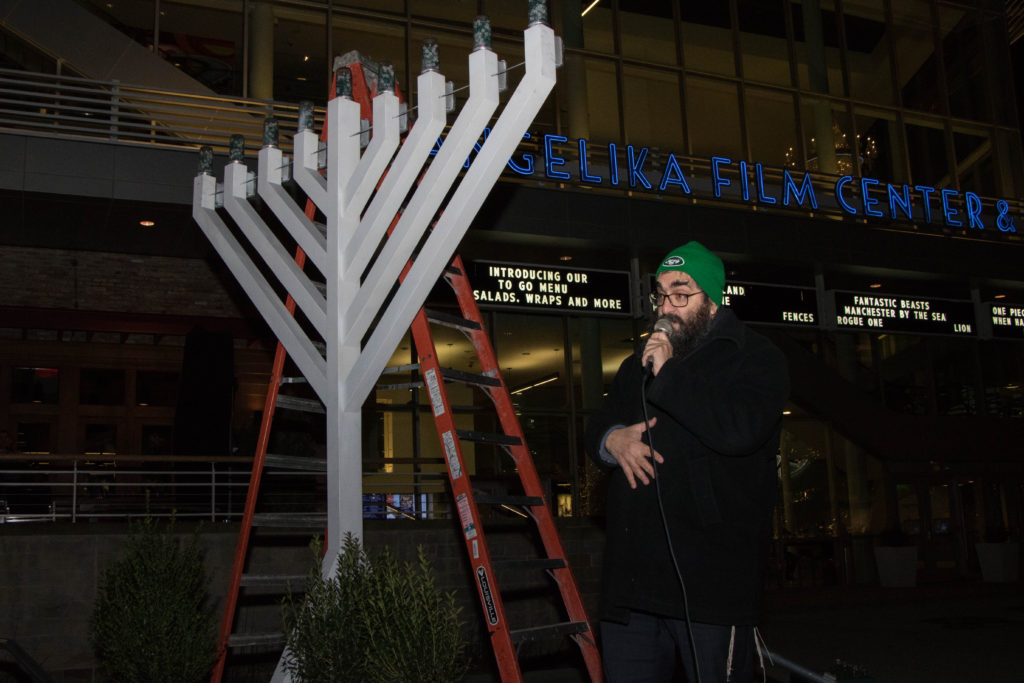 Rabbi Sholom Deitsch leads the Chanukah blessings. Photos by Justin Katz