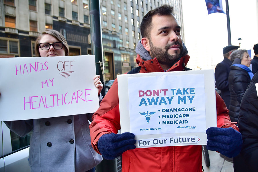 Protestors rally in support of the Affordable Care Act in Philadelphia in December.   Photo by Lisa Lake/Getty Images for Moveon.org
