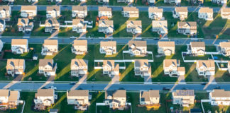 Aerial view of rows of suburban tract houses over Centerville, Maryland.
