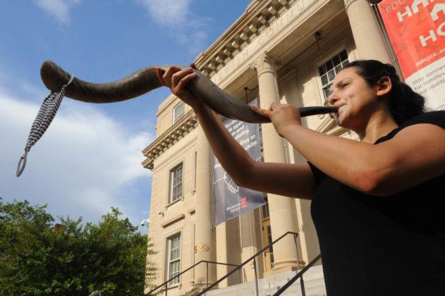 Shana Finkel blows a shofar. Photo by Lloyd Wolf