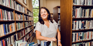 B'nai Israel librarian Jill Gendelman will leave requested books with the synagogue's security guard for pickup or get in her car and drop them off at a congregant's home.