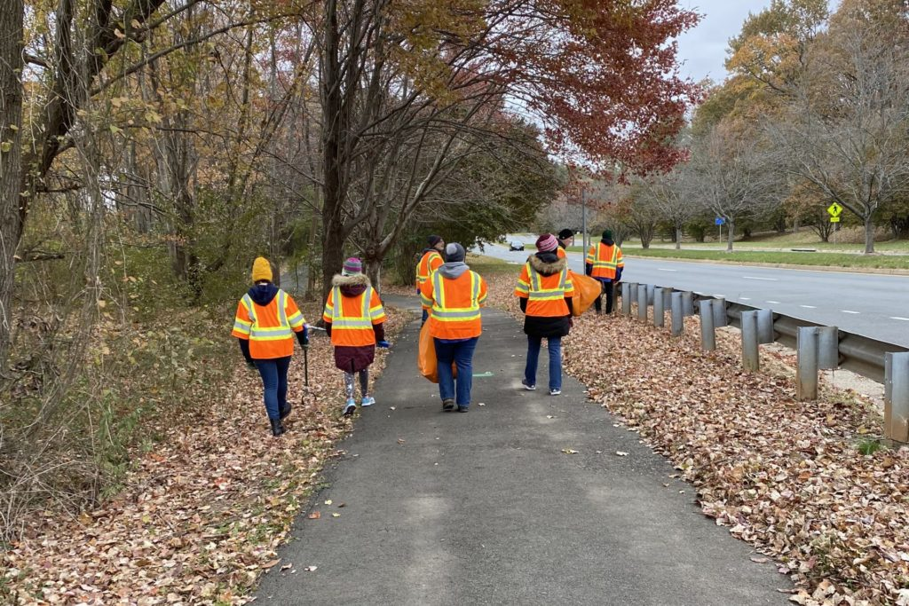 Northern Virginia Hebrew Congregation members gather in November 2019 to pick up trash along a two-mile stretch of Wiehle Avenue in Reston.