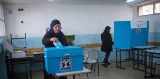 Arab Israelis cast their ballots at a polling station in the town of Beit Safafa in 2015.